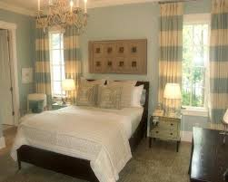 espresso furniture light blue walls striped curtains white bedding tan accents