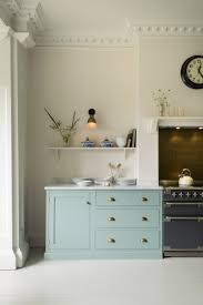 just kitchen designs. intricate coving and architrave details compliment the simple shaker kitchen design just perfectly designs