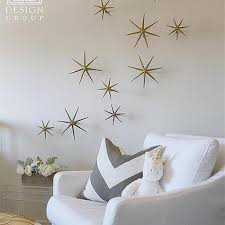 white nursery glider with gold wall stars on gold wall decor ideas