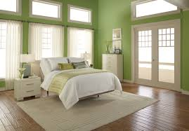 awesome sage green bedroom decorating ideas brown solid wood laminate flooring beige fabric modern rug white