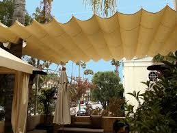 retractable fabric on cable patio cover