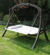 it's a hammock, no it's a swing, no it's a bed! Either way, take a pallet  and the old swing frame yes