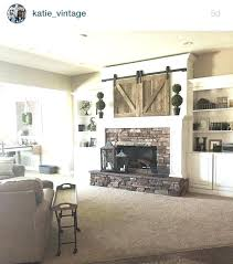 tv over fireplace ideas over fireplace ideas mantle barn doors over living room fireplace decorating ideas