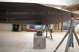 this is the front block blue tape of the boat being raised by the jack stands if you don t have jack stands you can use a hydraulic bottle jack to raise