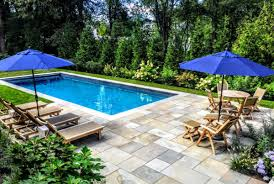 Rectangle pool Spas Linear Pool With Stone Patio Environmental Pools Swimming Pool Photo Gallery Pool Construction By Environmental Pools