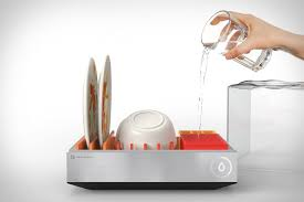 an image of a hang pouring a full glass of water into the heatworks tetra countertop