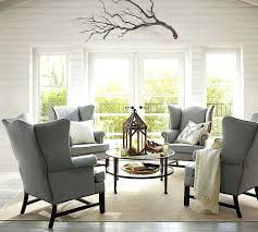 traditional living room with exposed beam by pottery barn tanner round coffee table side
