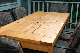 patio table with built in beer wine coolers with lids covered