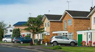 suburban houses with cars on driveways