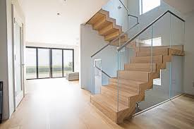 floating staircase with white oak wood starfire glass railings keep the beach feel throughout this