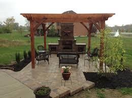 outdoor fireplace paver patio: davenport outdoor kitchen outdoor fireplace and paver patio in centerville ohi traditional patio