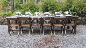 our hand crafted 10 farm tables benches french farm chairs barn doors arbors china and stemware compliment any venue