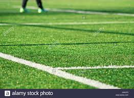 artificial green grass with white stripe of soccer field white line on a field play fake grass used sports fields for and t25 green