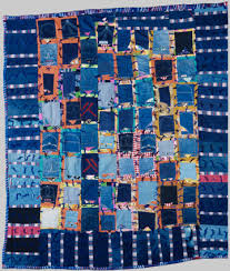 MSU Museum: Quilting Sisters: African-American Quiltmaking in Michigan & Photo of Blue Jean Pockets quilt made by Essie Lee Robinson in 1990. Adamdwight.com