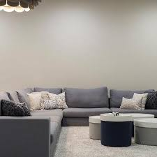 gray sectional with cered round coffee tables