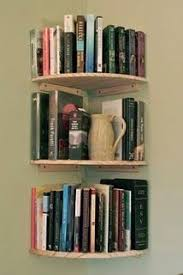 corner wall bookshelves $8.50 each shelf at the Home Depot. Yup, I may buy