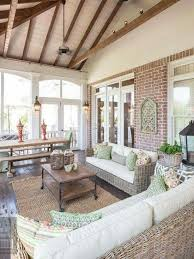 covered porch furniture. screenedin porch sunroom vaulted ceilings exposed wood beams neutrals white and beige brick wicker furniture covered o