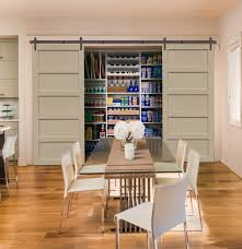 open gray barn door kitchen pantry beige walls