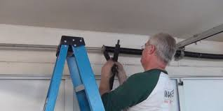 garage door spring repairGarage Doors of Maryland Broken Torsion  Extension Spring Repair
