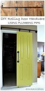 rolling door with diy hardware using plumbing pipe
