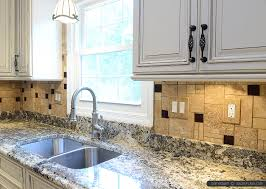beige kitchen cabinet granite countertop travertine backsplash tile with glass