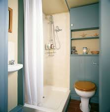front view of a toilet in a neat bathroom