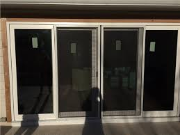 pictured here a four panel sliding glass door