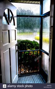 Wonderful Looking Out Front Door Through Screen Showing Rain On Decor