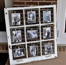 an old window en wire and clothespins for displaying photos great for those salvaged windows with broken panes you can still use the wood frames