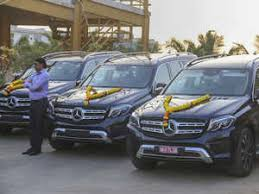 the cars were gifted to the employees at a ceremony in surat by former gujarat cm and madhya pradesh governor anandiben patel