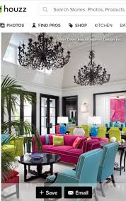 Lots of fun color. I love this! Look at those chandeliers painted black. No  wall color needed for this fab room. Black trim though!