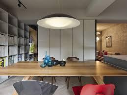 large pendant light above dining space brilliant taipei apartment