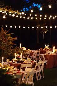outdoor fairy lighting. fairy lights wedding reception outdoor nighttime small and intimate lighting