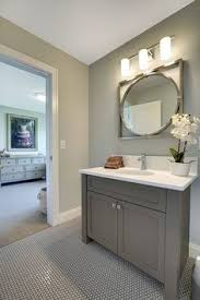 half bathroom ideas gray. This Bathroom Features Gray Walls, Vanity And Penny Round Floor Tiles With Dark Grout. Half Ideas