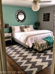 teal walls grey carpet grey teal bedroom chevron rug with teal wall and mirror is really pretty teal walls gray carpet