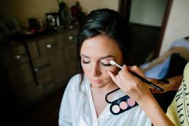 make up for a beautiful young bride made make up artist