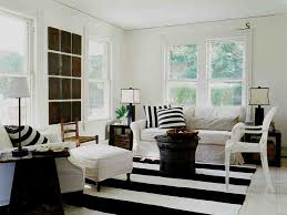 view in gallery striped rug black coffee table and accent pillows for the shabby chic living room