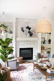 this is a gorgeous white painted fireplace love how bright it is have you