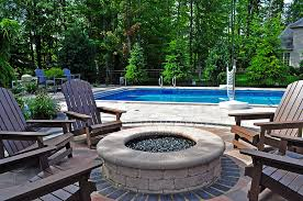 circular paver fire pit design with black glass cleveland