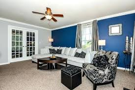 blue accent living room traditional living room with blue accent wall and sectional couch color for blue accent living room royal blue accent wall