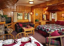 Best Canada: One Room Cabin Individual cabin with 1 queen bed facing a  wood-burning fireplace with sitting area and kitchenette, all in the same