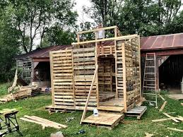 Small dwelling under construction made exclusively from used pallets.