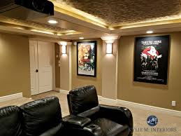 home theatre room with double doors black recliners posters textured acoustic ceiling