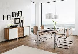 modern wood dining room sets: like architecture  team dining set window focal point