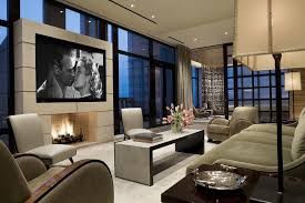 an example of traditional style with tv above the fireplace