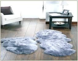grey faux fur rug grey faux fur rug sheepskin with regard to sheep skin plan 9