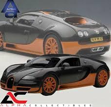Veyron nebol na prvej priečke najrýchlejších áut sveta veľmi dlho. 2011 Bugatti Veyron Super Sport Black With Orange Rims 1 18 Scale Minichamps For Sale Online Ebay