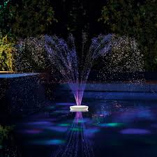 Floating Pool Fountain With Lights The Floating Lighted Pool Fountain Hammacher Schlemmer