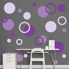 I just love all these polka dots on that wall, the grey really makes them