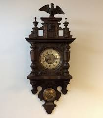 wooden wall clock so called free pendulum clock approx 1900 germany